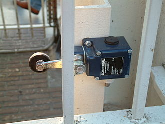 Limit switch - A limit switch with a roller-lever operator; this is installed on a gate on a canal lock, and indicates the position of a gate to a control system.