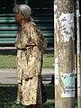 Elderly Woman by Tram Stop - Dnipropetrovsk - Ukraine (43436168324).jpg