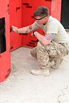 Engineer trooper paints castle for competition in Afghanistan 140421-A-MU632-629.jpg