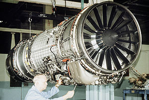 A technician works on the new F-110 turbofan e...