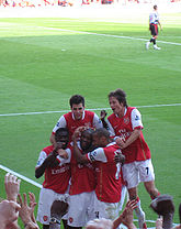 Fàbregas celebrates a goal with his Arsenal team-mates.