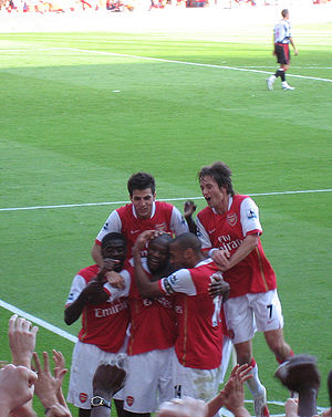 Cesc Fàbregas - Fàbregas celebrates a goal with his Arsenal teammates