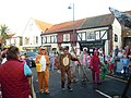 Fancy dress followers, Dunstable Arms float, Sheringham carnival parade, Wyndham Street, Sheringham 2014-08-06.JPG