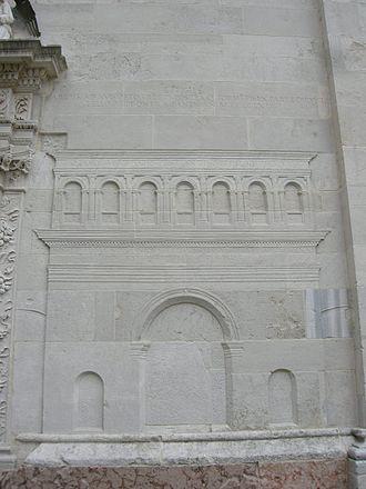 Arch of Augustus (Fano) - The Arch of Augustus, intact, in the bass-relief of the facade of the neighbouring church of St Michael