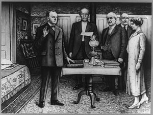 First inauguration of Calvin Coolidge - First correct composite photograph made of President Coolidge's first dramatic inaugural in Plymouth, Vt.  The oath is being administered by notary Colonel John Coolidge, the president's father, and witnessed by Mrs. Calvin Coolidge, Porter H. Dale, and Leonard L. Lane.