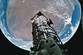 Fish-eye View of the Hubble Space Telescope and Earth (28051099871).jpg