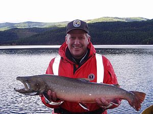 Bull trout - Fisherman with a big bull trout