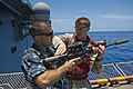 Flickr - Official U.S. Navy Imagery - A Marine how to properly handle an M4 rifle..jpg