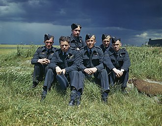 Lynn Garrison - Flight Lieutenant Joe McCarthy (fourth from left) and his crew of No. 617 Squadron (The Dambusters) at RAF Scampton, 22 July 1943. TR1128