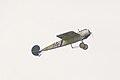 Fokker EIII Oblt Schildknecht Flyby 02 ThruDirtyWindow Dawn Patrol NMUSAF 26Sept09 (14413302578).jpg