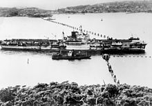 The British aircraft carrier HMS Formidable passing through the anti-submarine boom in Port Jackson (Sydney Harbour) in 1945 Formidable Sydney Boom (AWM P00444-047).jpg