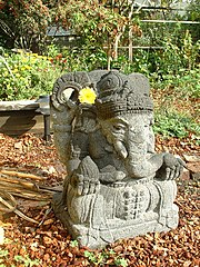 Statue of Ganesha with a flower
