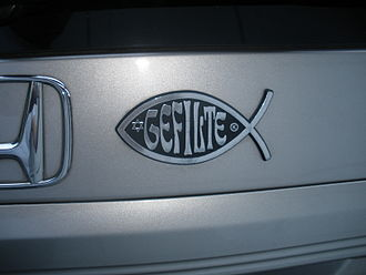 "Jewish humor - ""Gefilte fish"" on an automobile, a humoristic parody of the fish symbol"