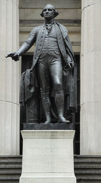 Federal Hall - George Washington  - 1883 statue by John Quincy Adams Ward on pedestal on the steps in front of Federal Hall National Memorial (old U.S. Custom House and Sub-Treasury of 1842) facing Wall Street at the approximate height of the previous original Federal Hall balcony where he was inaugurated first President in 1789