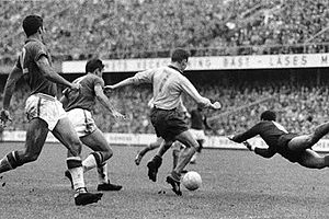 1958 FIFA World Cup Final - Swedish forward Hamrin (7) attempts to score in the final