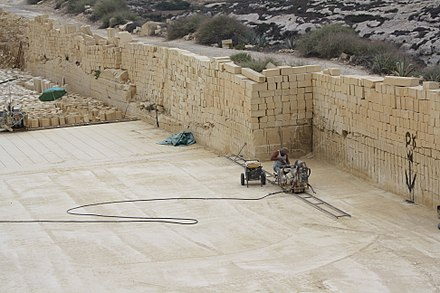 Cutting limestone blocks at a quarry in Gozo, Malta Gozo, limestone quarry - cutting the stone.JPG