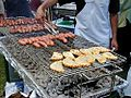 Grilling sausages empanadas barbecue charcoal.jpg