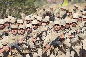 Self-Defense Forces (Rojava cantons) - HXP militiamen on parade.
