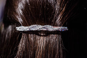 Barrette - A hair barrette on the back of a woman's head