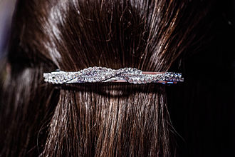 Barrette - A barrette on the back of a woman's head