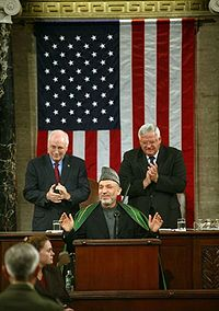Hamid Karzai as Interim President in June 2004 being applauded by politicians at the United States Congress in Washington, D.C.