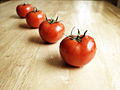 Healthy Red Tomatoes are Wet and Organic.png