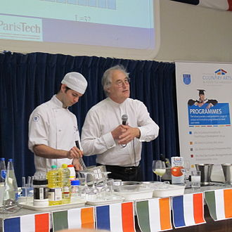 Hervé This - Hervé This at Dublin Institute of Technology, Cathal Brugha Street, 2011 with student Ciarán Elliott demonstrating how to achieve a greater volume when whipping egg whites.