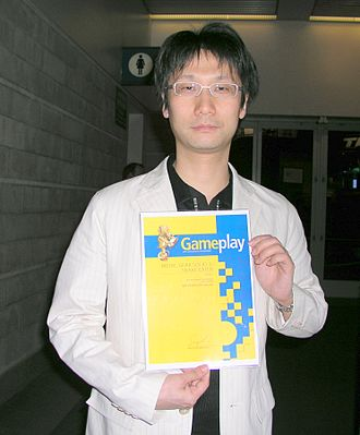 Metal Gear Solid 3: Snake Eater - Kojima at E3 2006 holding a Gameplay award for Best Story of the Year, 2005