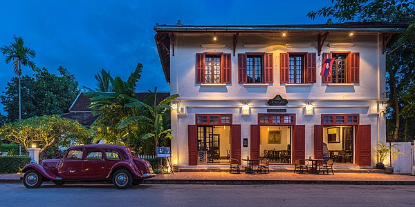Hotel 3 Nagas with old red Citroen at blue hour in Luang Prabang