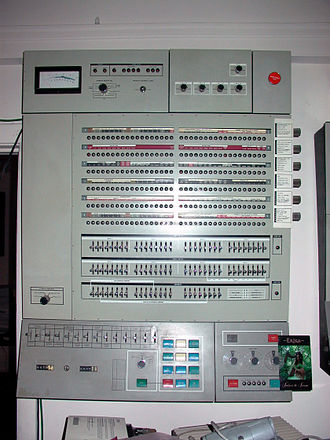 Program animation - System/360 (Model 65) operator's console, with register value lamps and toggle switches and buttons (middle of picture) .