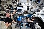 ISS-59 Nick Hague and Anne McClain work inside the Kibo lab.jpg