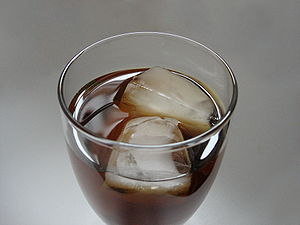 Ice cubes in a glass of iced tea. Lighting con...