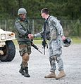 Indian Army Maj. Prashant Mishra is welcomed to a weapons range by Capt. Cullen Lind (cropped).jpg