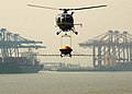 Indian Coast Guard Helicopter demonstrating oil pollution by chemical spraying equipment in the oil spill area at Jawaharlal Nehru Port Trust harbor, Mumbai, on March 28, 2008.jpg