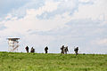 Indian soldiers and U.S. Army paratroopers move toward their objective after being dropped off by CH47 Chinook helicopters for a field training exercise in 2013.jpg