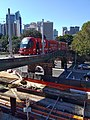 Inner West Light Rail passing above the CBD and South East Light Rail 20180311.jpg