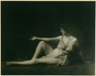 Isadora Duncan - Duncan in a Greek-inspired pose and wearing her signature Greek tunic. She took inspiration from the classical Greek arts and combined them with an American athleticism to form a new philosophy of dance, in opposition to the rigidity of traditional ballet.