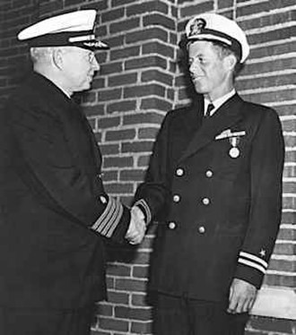 Frederick L. Conklin - Conklin awarding John F. Kennedy the Navy and Marine Corps Medal.
