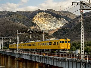 JNR 115-3000 in Setouchi yellow livery 2015-01-04.jpg