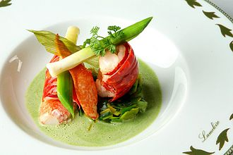 Cuisine - An example of nouvelle cuisine presentation. This dish consists of marinated crayfish on gazpacho asparagus and watercress.