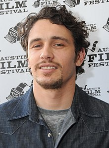 James Franco is smiling towards the camera.