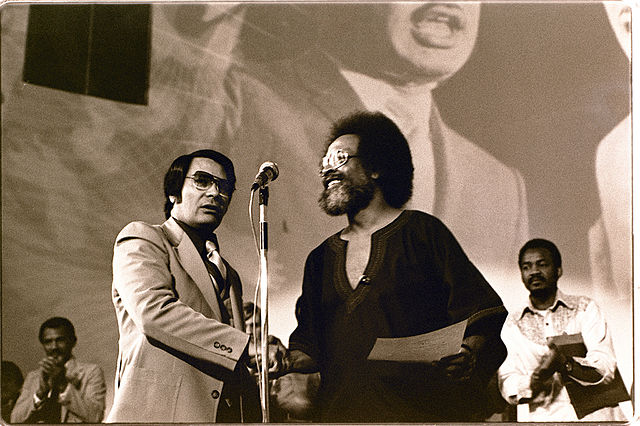 Jim Jones receives a Martin Luther King, Jr. Humanitarian award from Pastor Cecil Williams, 1977.