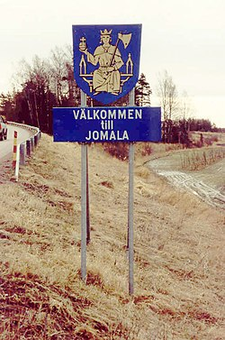 Welcome to Jomala! The coat of arms of Jomala features St. Olav sitting on a throne and holding an axe and a globus cruciger