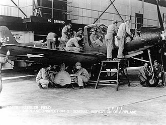 Technical Division, Air Training Command - Aircraft Mechanic Students at Keesler Field, Mississippi performing a general inspection of a Bell P-39 Airacobra ground training aircraft
