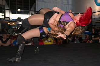 Kimber Lee - Lee performing a German suplex on LuFisto