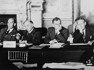 Paris Peace Treaties, 1947 - Canadian representatives at the Paris Peace Conference, Palais du Luxembourg. (L.-r.:) Norman Robertson, Rt. Hon. William Lyon Mackenzie King, Hon. Brooke Claxton, Arnold Heeney