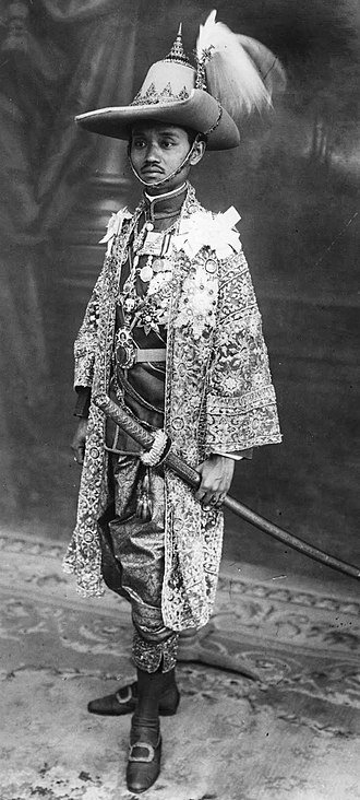 Siamese revolution of 1932 - King Prajadhipok wearing khrui and chang kben, armed with krabi