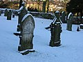 Kirkwhelpington churchyard in snow - geograph.org.uk - 236797.jpg