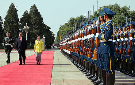 Chinese President Xi Jinping and a military honor guard welcomes South Korean president Park Geun-hye in June 2013. Korea President Park China Welcoming Ceremony 20130627 01.jpg