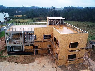 Oriented strand board - OSB is used in housing construction.